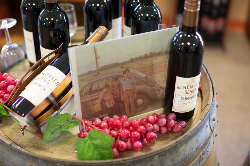 Winemaker Series wines with Hoffherr boys picture on a barrel - St. James Winery