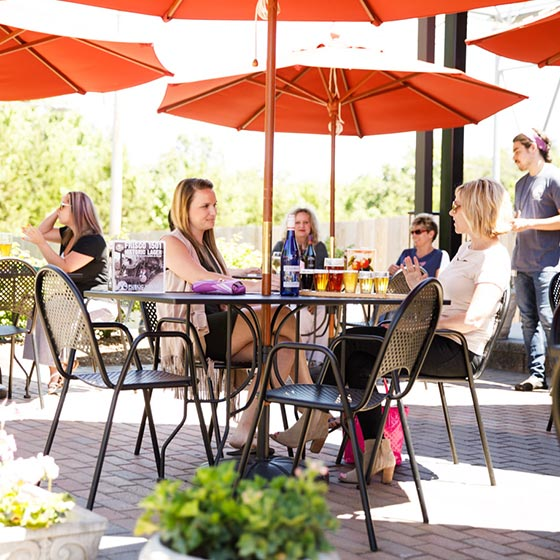Parties enjoy drinks at outdoor seating on campus - St. James Winery