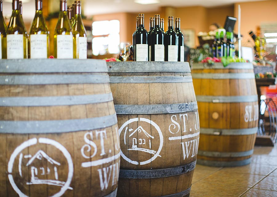 Wine on display on barrels in St. James Winery shop