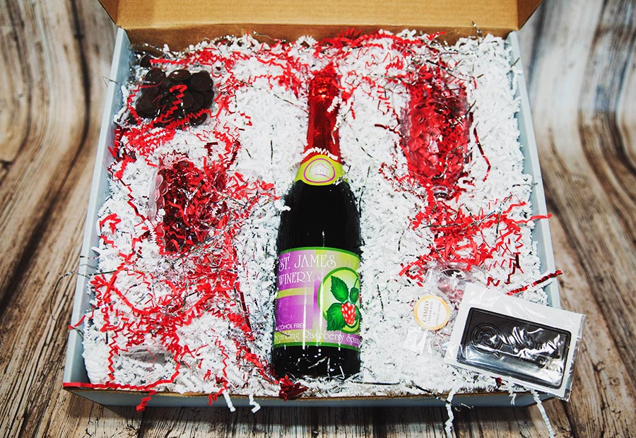 St. James Sweeties Sparkling Raspberry Juice Gift Box - Includes: St. James Winery Sparkling Raspberry Juice, chocolate tasting discs, St. James chocolate bar, plastic flutes X 2.